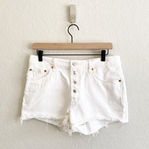 Levi's High Waisted White Denim Distressed Shorts